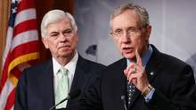 Senate Majority Leader Harry Reid (D-NV), right, and Senate Banking Committee Chairman Christopher Dodd (D-CT) speak to the media after the final vote on Wall Street reform in Washington. (Mark Wilson/Getty Images)