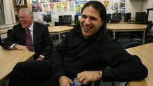 Theoretical physicist Nima Arkani-Hamed, right, is shown in a 2007 file photo after reuniting with Charles Ledger, his Grade 8 math teacher in Waterloo, Ont. Prof. Arkani-Hamed is one of nine physicists to receive funds from billionaire Russian investor Yuri Milner. (Glenn Lowson for The Globe and Mail)