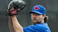 Toronto Blue Jays starting pitcher R.A. Dickey throws warm up pitches while playing against the Philadelphia Phillies during first inning MLB Grapefruit League baseball action in Dunedin, Fla., on March 2, 2013. (Nathan Denette/The Canadian Press)