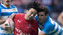 Canada's Nathan Hirayama and Argentina's Luciano Gonzalez Rizzoni collide during World Rugby Sevens Series action, in Vancouver, B.C., on March 12, 2017. (DARRYL DYCK/THE CANADIAN PRESS)