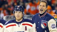 New York Rangers coach John Tortorella, right, argues a penalty call as Brad Richards looks on late in the third period of the NHL Winter Classic hockey game against the Philadelphia Flyers, Monday, Jan. 2, 2012, in Philadelphia. (Associated Press)