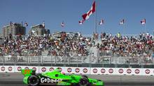 James Hinchcliffe, of Canada, passes a grandstand during the Toronto Indy race in Toronto on Sunday, July 14, 2013. (Chris Young/THE CANADIAN PRESS)