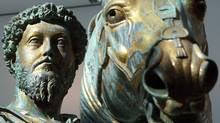 The gilded bronze equestrian statue of Marcus Aurelius, dating to the Roman emperor's reign, appears in its new hall at the Capitoline museum in Rome. Organizers of Stoic Week are urging participants to keep daily journals just as he did. (CHRIS HELGREN/REUTERS)