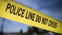 Police tape is shown in this April 30, 2014 file photo. (John Lehmann/The Globe and Mail)