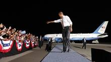 Barack Obama points to the crowd as he arrives for a campaign rally in Cleveland, Ohio October 25, 2012. Obama is on a two-day, eight state, campaign swing. In the background is Air Force One. (Kevin Lamarque/Reuters)