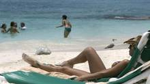 A tourist sunbathes at the resort city of Cancun, Mexico. File photo 2009. (Israel leal/AP)