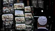 A Pakistani man looks at mirrors displayed for sale outside an accessory shop for cars, in Rawalpindi, Pakistan, Wednesday, Feb. 22, 2012. (AP Photo/Muhammed Muheisen) (Muhammed Muheisen/Muhammed Muheisen/AP)