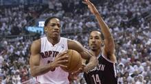 Toronto Raptors' DeMar DeRozan, left, drives at Brooklyn Nets' Shaun Livingston during first half NBA playoff basketball action in Toronto on Saturday April 19. (Chris Young/THE CANADIAN PRESS)