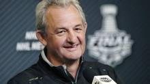 Los Angeles Kings head coach Darryl Sutter smiles as he answers questions from the media after an optional practice for Game 4 of the Stanley Cup Finals at Madison Square Garden in New York, Tuesday, June 10, 2014. (Kathy Willens/AP)