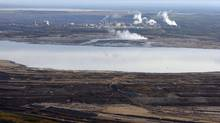 This Sept. 19, 2011 aerial photo shows an oil sands tailings pond at a mine facility near Fort McMurray, Alta. (Jeff McIntosh/THE CANADIAN PRESS)