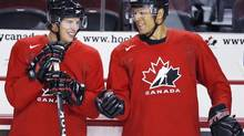 Sidney Crosby, left, and Jarome Iginla, chat during a practice at the Men's National Olympic Hockey Team orientation camp in Calgary, Tuesday, Aug. 25, 2009. The Calgary Flames have traded team captain Jarome Iginla in exchange for forwards Kenneth Agostino and Ben Hanowski and the Pittsburgh Penguins 2013 first round pick. (Jeff McIntosh/THE CANADIAN PRESS)