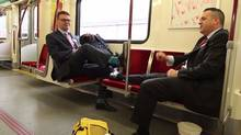 "Chris Upfold, Chief Customer Officer, and Brad Ross, Executive Director Corporate Communications, demonstrate acceptable behaviour on one of the TTC's new ""personal cars."" (Youtube)"