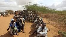 Somali refugees wait to receive humanitarian aid in Kenya's Dadaab Refugee Camp, northeast of Nairobi. (REUTERS)