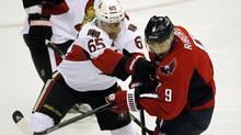 Ottawa Senators defenceman Erik Karlsson mixes it up with Washington Capitals centre Mike Ribeiro in Washington Thursday night. (KEVIN LAMARQUE/REUTERS)