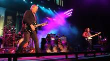 It's been a long week for Rush and a long time coming, their long-awaited induction into the Rock and Roll Hall of Fame and the unusual schedule it's created. (Robb Cohen/The Canadian Press)