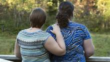 Alisha, left, and Julie, walk in a park in Halifax on Thursday, Sept. 13, 2012. Seven years after the federal government gave its blessing to same-sex marriage, it's clear Canada's gay and lesbian couples have been seizing the wedding day (Andrew Vaughan/The Canadian Press)