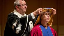 UBC President and Vice-Chancellor Stephen Toope, left, places a hood on Dr. Donna Lester-Smith during a convocation ceremony in Vancouver. (DARRYL DYCK For The Globe and Mail)
