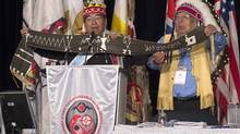 Stephen Augustine, a hereditary chief from the Elsipogtog Mi'kmaq First Nations, and Mi'kmaq Nation Grand Chief, Ben Sylliboy, right, display a wampum belt as native leaders from across Canada attend the Assembly of First Nations' 35th annual general meeting in Halifax on Tuesday, July 15, 2014. (Andrew Vaughan/THE CANADIAN PRESS)