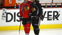 Chicago Blackhawks centre Jonathan Toews (L) talks with teammate Nick Leddy (R) during team practice in Chicago, Illinois, June 21, 2013. Game 5 of the NHL Stanley Cup Finals hockey series against the Boston Bruins will be played on June 22. (JEFF HAYNES/REUTERS)