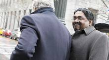 Galleon hedge fund founder Raj Rajaratnam, right, arrives at Manhattan Federal Court for his insider trading case in New York March 23, 2011. (Brendan McDermid/Reuters)