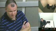 """Col. Russell Williams is shown in this court-released image from his interrrogation by police captured on video and shown Wednesday in a Belleville, Ont. courtroom. Williams told police that while he did ask himself why he raped and killed women he could never come up with an answer and he was """"pretty sure the answers don't matter."""" (The Canadian Press)"""