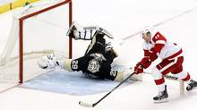 Pittsburgh Penguins goalie Marc-Andre Fleury makes an acrobatic save against Detroit Red Wings right wing Daniel Alfredsson during the shootout at the CONSOL Energy Center. (Charles LeClaire/USA Today Sports)