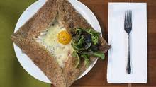 Café Linnea's French influence shines in dishes such as this Leek and Gribiche Galette, comprised of a poached egg nestled in a bed of charred leek and rich sauce atop a buckwheat crêpe. (Amber Bracken/The Globe and Mail)