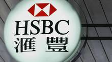A company logo of HSBC is displayed outside its branch in Hong Kong August 3, 2009. HSBC Holdings Plc, Europe's biggest bank, said its first half profits halved from a year ago to $5 billion as it was hit by rising bad debts in the United States, Europe and Asia. REUTERS/Bobby Yip (CHINA BUSINESS) (BOBBY YIP/REUTERS)