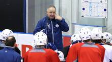 Toronto Maple Leafs coach Randy Carlyle speaks to the players during a training session as the Leafs prepare for the new NHL season in Toronto on Tuesday January 15, 2013. (Chris Young/THE CANADIAN PRESS)