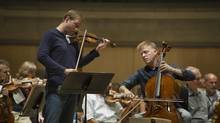 Violinist Jonathan Crow and cellist Joseph Johnson rehearse at Roy Thomson Hall in Toronto. (Kevin Van Paassen for The Globe and Mail)