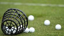 A generic photo of golf balls on a practice range (Ross Kinnaird/2010 Getty Images)
