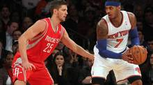 New York Knicks small forward Carmelo Anthony (7) controls the ball against Houston Rockets small forward Chandler Parsons (25) during the second quarter of a game at Madison Square Garden. (BRAD PENNER/USA TODAY SPORTS)
