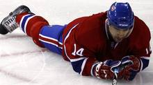 Montreal Canadiens center Tomas Plekanec reacts after being hit to the ice during the third period of their NHL hockey game against the Washington Capitals in Montreal March 26, 2011. REUTERS/Shaun Best (SHAUN BEST)