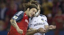 Toronto FC's Torsten Frings battles for the ball with LA Galaxy's Mike Magee (R) during the first half of their CONCACAF Champions League quarter finals soccer match in Toronto, March 7, 2012. (MARK BLINCH/REUTERS)
