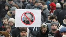Opposition supporters gather before a protest demanding fair elections in central Moscow March 5, 2012. (DENIS SINYAKOV/REUTERS/DENIS SINYAKOV/REUTERS)