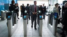 Vancouver Mayor Gregor Robertson passes through Compass fare gates at Richmond-Brighouse Station. Thousands of Vancouver transit users jammed complaint lines on Jan. 4. (DARRYL DYCK For The Globe and Mail)