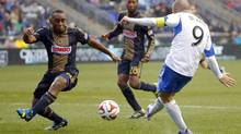 Montreal Impact forward Marco Di Vaio (9) shoots and scores a goal past Philadelphia Union midfielder Amobi Okugo (14) in the second half at PPL Park. Game ended in 1-1 tie. (Jim O'Connor/USA Today Sports)