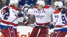 Washington Capitals Alex Ovechkin (C) and Marcus Johansson (R) celebrate a goal scored by Keith Aucoin (L) in the second period of their NHL hockey game against Toronto Maple Leafs in Toronto February 25, 2012. REUTERS/Fred Thornhill (Fred Thornhill/Reuters)
