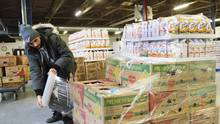 A worker wraps a shipment for delivery at the distribution centre for Moisson Montreal, the largest food bank in Canada, Thursday, Jan. 28, 2016 in Montreal. (Ryan Remiorz/THE CANADIAN PRESS)