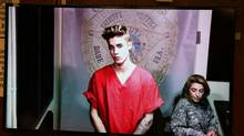 This Jan. 23, 2014, file photo shows Justin Bieber appearing in court via video feed in Miami. (Walter Michot/AP)