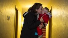 Gillian Quigley with her eight-month-old daughter, Isla, in the lobby of their building in Vancouver on Oct. 2, 2013. (JOHN LEHMANN/THE GLOBE AND MAIL)