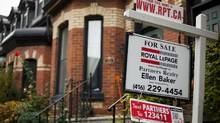 "A ""For Sale"" sign is posted outside of at Toronto townhome Tuesday Oct. 25, 2011. (Tim Fraser/Tim Fraser for The Globe and Mail)"