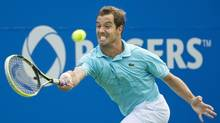 Richard Gasquet of France returns the ball against John Isner of the United States during semi final Rogers Cup tennis action in Toronto on Saturday, August 11, 2012. Gasquet defeated Isner to advance to the finals. (Nathan Denette/THE CANADIAN PRESS)