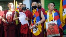 Tibetan monks hold placards showing the monks who had set themselves on fire to protest Chinese rule in Tibet during a march in Dharamshala on Oct. 14, 2011. (LOBSANG WANGYAL/AFP/Getty Images)