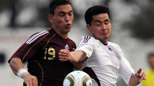 Venezuelan player Henry Pernia (L) vies for the ball with Kim Myong Won of North Korea during a friendly football match in San Felipe Yaracuy, 300 km west of Caracas on March 4, 2010. Getty Images/Juan BARRETO
