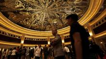 Tourists walk inside the Wynn Macau hotel in this 2009 photo. (TYRONE SIU/TYRONE SIU/REUTERS)