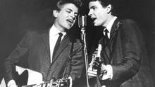 The Everly Brothers, Don and Phil, perform on July 31, 1964. Phil Everly, part of the pioneering rock 'n' roll duo with his brother, has died at age 74. (AP)