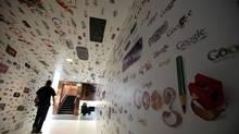 A man walks through a tunnel of Google homepage logos at the Google campus near Venice Beach, in Los Angeles, California January 13, 2012. (© Lucy Nicholson / Reuters/REUTERS)