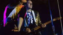 Win Butler, right, and Regine Chassagne of Arcade Fire, perform Oct. 24, 2013 at the Little Haiti Cultural Center in Miami. (Eric Kayne/AP)