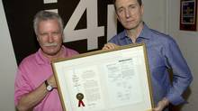 i4i founder Michael Vulpe (left) and chairman Loudon Owen hold the original patent cited in its lawsuit against Microsoft at the company's headquarters in Toronto on June 9, 2011. (Frank Gunn)